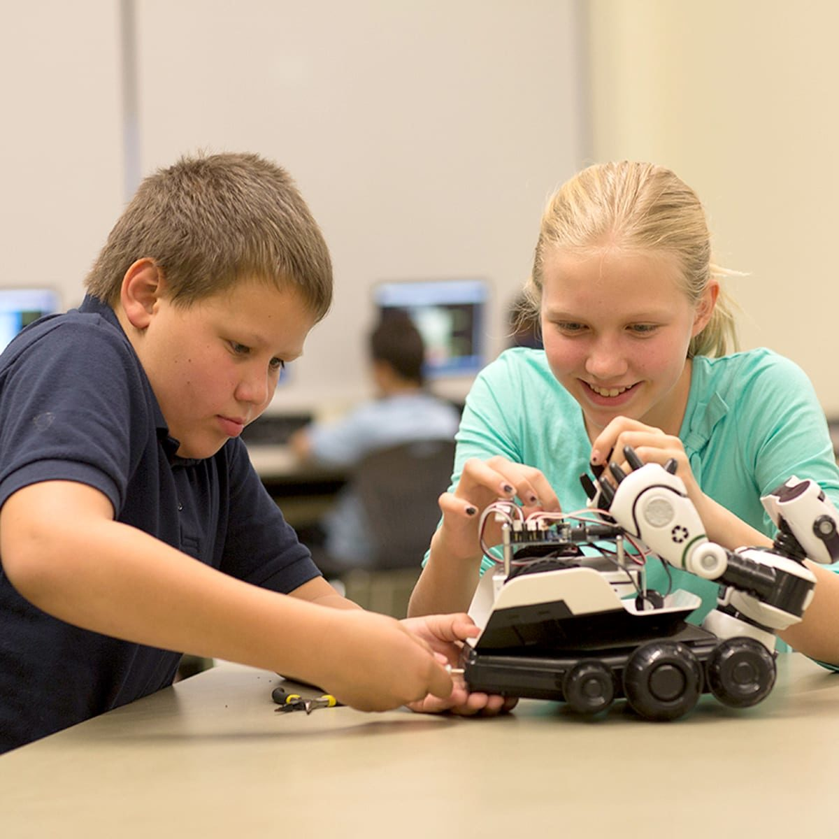 kids working on robot